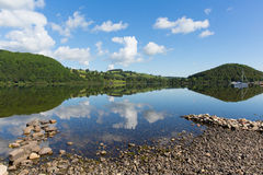 Ullswater by Pooley Bridge Lake District Cumbria rocky shore blue sky and sunshine Stock Photo