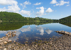 Ullswater by Pooley Bridge Lake District Cumbria rocky shore blue sky and sunshine Royalty Free Stock Photos