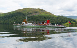 Ullswater Steam ferry with holidaymakers and tourists Lake District with green hills Stock Photography
