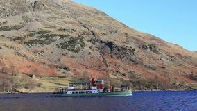 Ullswater Steamer. A video of an Ullswater steamer.  The steamer is seen approaching Glenridding on Ullswater lake in the English Lake District national park stock video