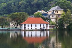The Queen`s bathing house on lake Kandy - Sri lanka. The Ulpange or the Queen's Bathing Pavilion is situated partly in the waters of the Kandy Lake and stock photo