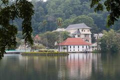 The Queen`s bathing house on lake Kandy - Sri lanka. The Ulpange or the Queen's Bathing Pavilion is situated partly in the waters of the Kandy Lake and stock photos