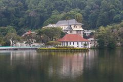 The Queen`s bathing house on lake Kandy - Sri lanka. The Ulpange or the Queen's Bathing Pavilion is situated partly in the waters of the Kandy Lake and royalty free stock photos