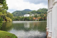 Lake Kandy with The Queen`s bathing house in the forground - Sri lanka. The Ulpange or the Queen's Bathing Pavilion is situated partly in the waters of stock photo