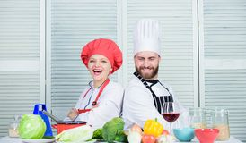 Ultimate cooking challenge. Family cooking in kitchen. man and woman chef cooking. vegetarian. cook uniform. Dieting and. Ultimate cooking challenge. Family royalty free stock photo
