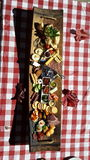 Gourmet cheeseboard on a gingham  cloth Stock Photography