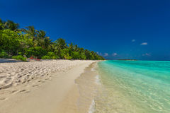 Ultimate destination beach on a tropical island, Maldives Royalty Free Stock Images