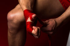 Ultimate Fighter Putting Straps On His Hands Stock Images