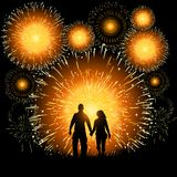 Ultimate Fireworks Finale. A couple watch an amazing finale to a fireworks display Stock Photos