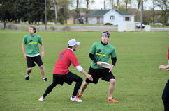 Ultimate Frisbee Battle. Ultimate Frisbee players battle in Bozeman Montana in the recent annual bozo tournament. The sport is currently one of the fastest Stock Photos