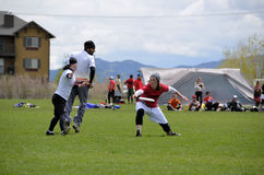 Ultimate Frisbee Throw. Ultimate Frisbee players battle in Bozeman Montana in the recent annual bozo tournament. The sport is currently one of the fastest Royalty Free Stock Photos