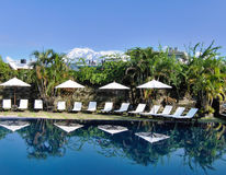Ultimate Getaway. Swimming pool with snow capped mountains as backdrop Royalty Free Stock Photography