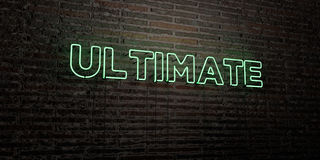 ULTIMATE -Realistic Neon Sign on Brick Wall background - 3D rendered royalty free stock image Stock Photos
