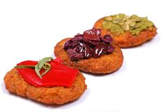 Meatless fritters topped with veggies royalty free stock images