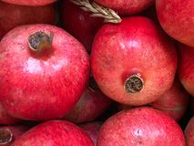 Ultra close up of Pomegranates. Extreme close up of bright red ripe pomegranates. Overhead light highlights the textured skins Royalty Free Stock Photo
