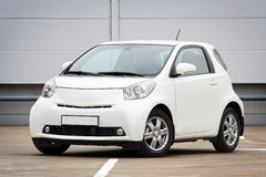 Ultra compact city car. 3/4 front view of ultra compact city car on a parking lot Stock Images