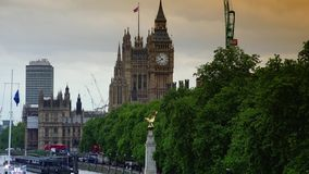 ULTRA HD 4k, real time, Big Ben along Thames with traffic. LONDON - circa 2015: Big Ben seen now named Elizabeth Tower in the distance with London city traffic stock footage