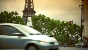 Ultra HD 4k,real time,Car traffic in Paris under Eiffel Tower, crowded street,. PARIS, FRANCE - June 27, 2015 Car traffic in Paris under Eiffel Tower, crowded stock video footage