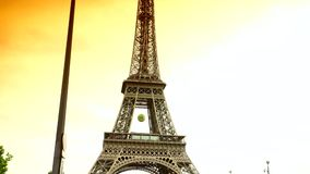 Ultra HD 4k,real time,Car traffic in Paris under Eiffel Tower, crowded street,. PARIS, FRANCE - June 27, 2015 Car traffic in Paris under Eiffel Tower, crowded stock footage