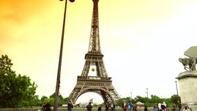 Ultra HD 4k,real time,Car traffic in Paris under Eiffel Tower, crowded street,. PARIS, FRANCE - June 27, 2015 Car traffic in Paris under Eiffel Tower, crowded stock video