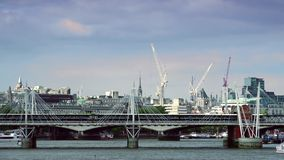 ULTRA HD 4k, real time, London skyline with boats and bridge on Thames river stock video