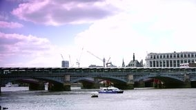 ULTRA HD 4k, real time, London skyline with boats and bridge on Thames river. London, UK- Circa 2015: London skyline and boats on Thames river in a sunny day stock video