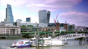ULTRA HD 4k, real time, London skyline with boats and bridge on Thames river stock video footage