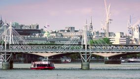 ULTRA HD 4k, real time, London skyline with boats and bridge on Thames river stock footage