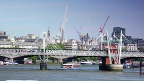 ULTRA HD 4k, real time, London skyline with boats and bridge on Thames river. London, UK- Circa 2015: London skyline and boats on Thames river in a sunny day stock video footage