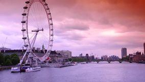 ULTRA HD 4k, real time, London skyline with London Eye on Thames river. LONDON - MAY 15: London skyline with London Eye on Thames river in a cloudy day on May 15 stock video