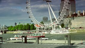 ULTRA HD 4k, real time, London skyline with London Eye on Thames river. LONDON - MAY 15: London skyline with London Eye on Thames river in a cloudy day on May 15 stock footage