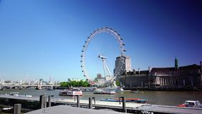 ULTRA HD 4k, real time, London skyline with London Eye on Thames river. LONDON - MAY 15: London skyline with London Eye on Thames river in a cloudy day on May 15 stock video footage
