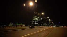 ULTRA HD 4k, real time, London skyline on Thames river with Shard in the background in the night. LONDON - MAY 10 2015: London skyline on Thames river with Shard stock video footage