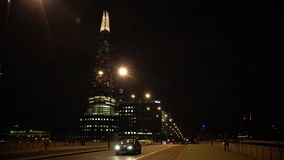 ULTRA HD 4k, real time, London skyline on Thames river with Shard in the background in the night. LONDON - MAY 10 2015: London skyline on Thames river with Shard stock footage