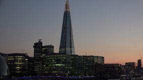 ULTRA HD 4k, real time, London skyline on Thames river with Shard in the background at sunset. LONDON - MAY 10 2015: London skyline on Thames river with Shard in stock footage
