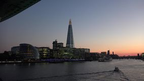 ULTRA HD 4k, real time, London skyline on Thames river with Shard in the background at sunset. LONDON - MAY 10 2015: London skyline on Thames river with Shard in stock video footage