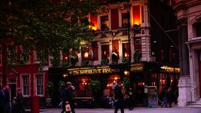 ULTRA HD 4k, real time, people have a drink at Sherlock Holmes pub in London