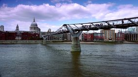 ULTRA HD 4k, real time, People walking over Millennium bridge with St. Paul iconic London Image. stock video