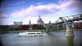 ULTRA HD 4k, real time, People walking over Millennium bridge with St. Paul iconic London Image. stock footage