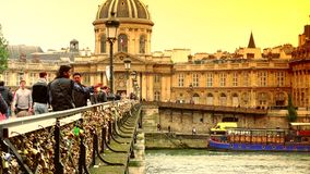 ULTRA HD 4k, real time, The Pont Des Artes bridge in Paris. PARIS, FRANCE - CIRCA 2015 - The Pont Des Artes bridge in Paris features locks from couples stock footage
