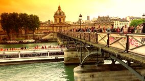 ULTRA HD 4k, real time, The Pont Des Artes bridge in Paris. PARIS, FRANCE - CIRCA 2015 - The Pont Des Artes bridge in Paris features locks from couples stock video