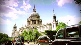 ULTRA HD 4k, real time, St Paul's Cathedral , Church of England with traffic cars. LONDON - CIRCA 2015: St. Paul's Cathedral circa MAY, 2015 in London. St Paul's stock video