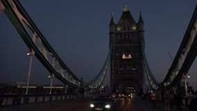 ULTRA HD 4k, real time, Tower Bridge is an iconic symbol of London in night. LONDON - JUNE 12, 2015: Traffic crosses Tower Bridge in London. Tower Bridge is an stock footage