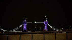 ULTRA HD 4k, real time, Tower Bridge is an iconic symbol of London in night. LONDON - JUNE 12, 2015: Traffic crosses Tower Bridge in London. Tower Bridge is an stock video