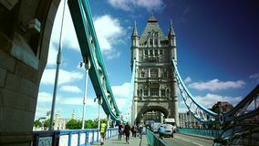 ULTRA HD 4k, real time, Tower Bridge is an iconic symbol of London in sunny day. LONDON - JUNE 12, 2015: Traffic crosses Tower Bridge in London. Tower Bridge is stock video