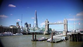 ULTRA HD 4k, real time, Tower Bridge is an iconic symbol of London in sunny day. LONDON - JUNE 12, 2015: Traffic crosses Tower Bridge in London. Tower Bridge is stock footage