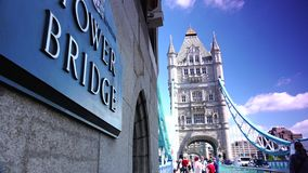 ULTRA HD 4k, real time, Tower Bridge is an iconic symbol of London in sunny day. LONDON - JUNE 12, 2015: Traffic crosses Tower Bridge in London. Tower Bridge is stock video footage