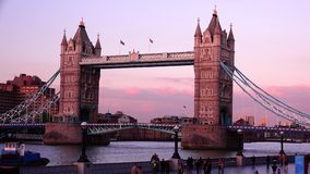 ULTRA HD 4k, real time, Tower Bridge is an iconic symbol of London in sunset. LONDON - JUNE 12, 2015: Traffic crosses Tower Bridge in London. Tower Bridge is an stock footage