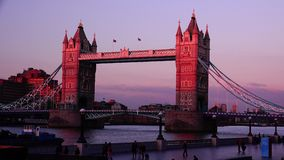 ULTRA HD 4k, real time, Tower Bridge is an iconic symbol of London in sunset. LONDON - JUNE 12, 2015: Traffic crosses Tower Bridge in London. Tower Bridge is an stock video footage