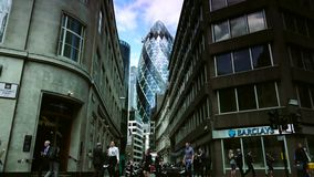 ULTRA HD 4k, real time, Traffic and pedestrians on City, modern building in London,. LONDON, UK - circa 2015: Traffic and pedestrians on City, modern building in stock footage